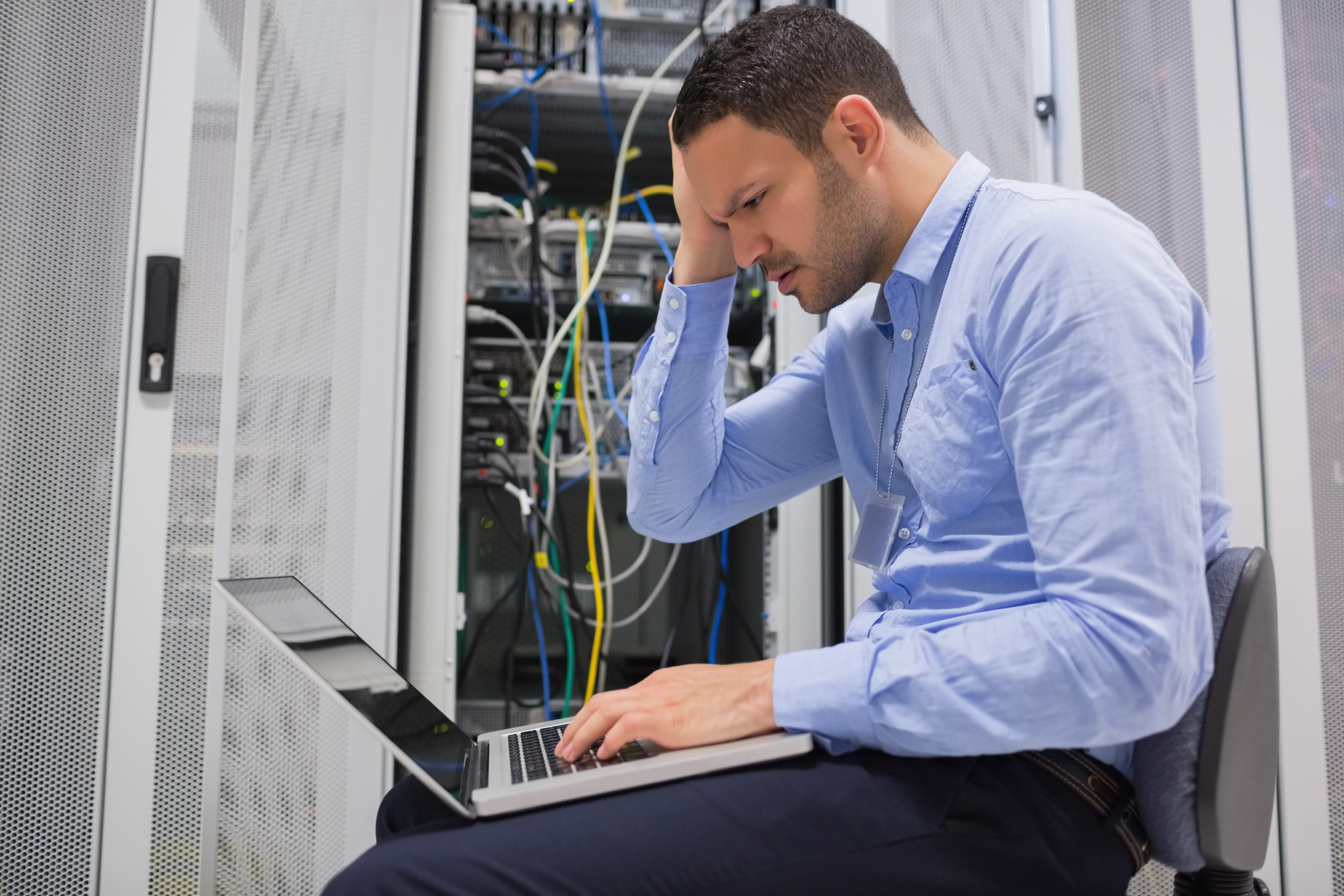 Technician becoming stressed over servers in data center of IT provider